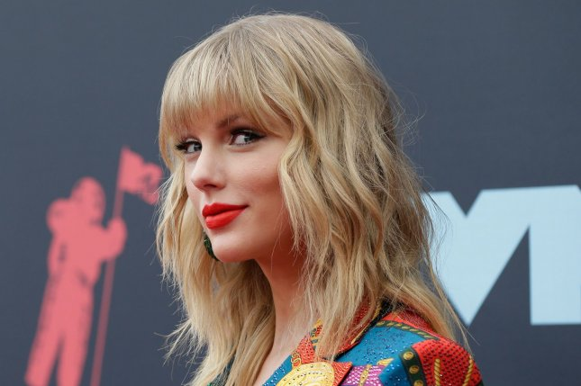 Taylor Swift and Stephen Colbert discussed her song Hey Stephen on The Late Show. File Photo by John Angelillo/UPI