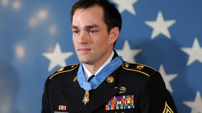 Former Army Staff Sergeant Clinton Romesha is seen with the Medal of Honor after being given the honor by President Barack Obama during a ceremony in the East Room at the White House in Washington on February 11, 2013. Romesha is receiving the medal for his courageous actions while defending a combat outpost in Afghanistan in 2009. UPI/Kevin Dietsch
