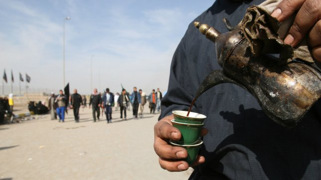 Coffee is poured for Shi'ite pilgrims in Baghdad's Saidiya District. (UPI Photo/Ali Jasim)