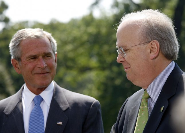 White House Deputy Chief of Staff Karl Rove (R) announces his resignation as U.S. President George W. Bush listens on the South Lawn of the White House on August 13, 2007. Rove is widely credited with being the architect of Bush's Presidential election victories. (UPI Photo/Aude Guerrucci/POOL).
