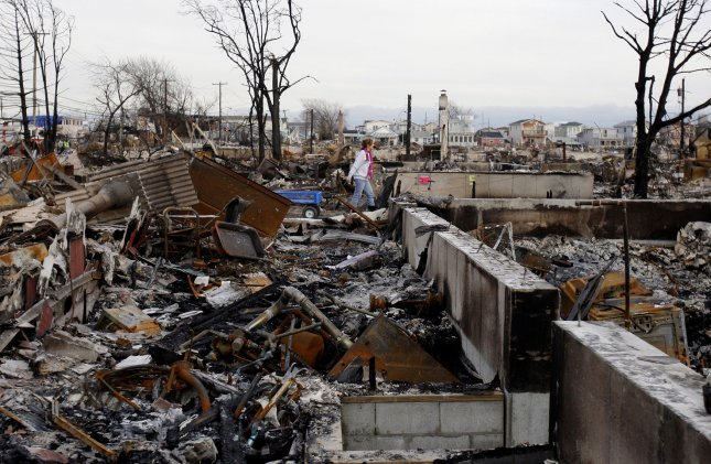 NYC provides free counseling for those struggling with Hurricane Sandy. Clean up continues in area of Breezy Point where 80 to 100 buildings burned to the ground 16 days after Hurricane Sandy hits the north east section of the United States in New York City. UPI/John Angelillo