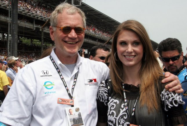 TV host and Indy Car owner David Letterman is photographed with a fan before the start of the 92nd running of the Indianapolis 500 at the Indianapolis Motor Speedway on May 25, 2008 in Indianapolis. (UPI Photo/Mike Bryand)