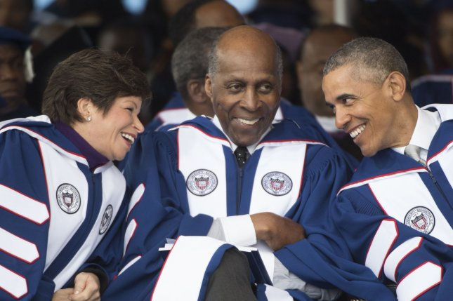 President Barack Obama, right, chats with advisers Valerie Jarrett and Vernon Jordan prior to delivering the Howard University Commencement speech, in Washington on Saturday. Obama encouraged graduates at the historically black school to be confident in your blackness. Photo by Molly Riley/UPI