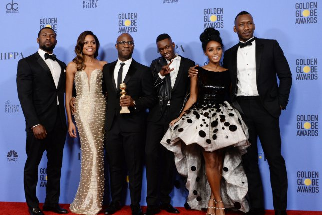 Cast members Trevante Rhodes, Naomie Harris, director Barry Jenkins, Ashton Sanders, Janelle Monae and Mahershala Ali of Moonlight, winner of Best Motion Picture -- Drama, appear backstage during the 74th annual Golden Globe Awards on January 8. Several members of the cast will serve as presenters at the SAG Awards gala on Sunday. Photo by Jim Ruymen/UPI