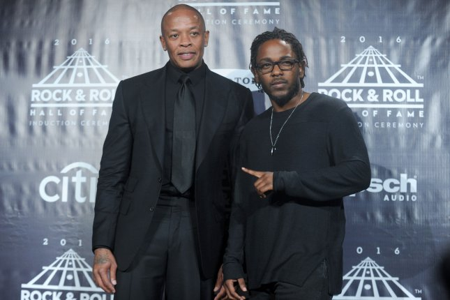 Dr. Dre (L) and Kendrick Lamar arrive in the press room at the 31st Annual Rock And Roll Hall Of Fame Induction Ceremony on April 8, 2016. Lamar has been nominated for eight MTV video music awards ahead of fellow artists Katy Perry and The Weeknd. File Photo by Dennis Van Tine/UPI