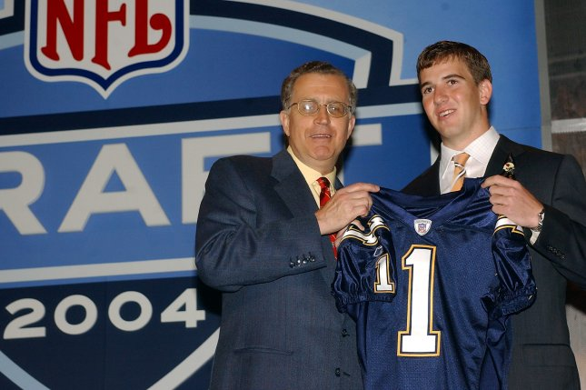 Former NFL Commissioner Paul Tagliabue (L) poses with the top overall draft choice, Eli Manning, who was chosen by the then-San Diego Chargers and later traded to the New York Giants on April 24, 2004 at the 2004 NFL Draft held in New York. File photo by Ezio Petersen/UPI