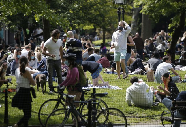 People gather in Washington Square Park for Memorial Day Weekend during the coronavirus pandemic in New York City in May 24. Photo by John Angelillo/UPI