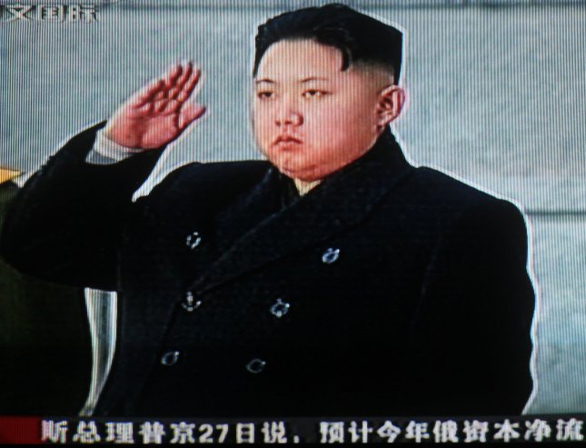 China's state television shows footage of Kim Jong-un saluting his father North Korean leader Kim Jong-Il's body during a state funeral in Pyongyang December 28, 2011. China offered its deep condolences on the death of North Korean leader Kim Jong-Il, which analysts said will spur China's leaders to boost ties with Pyongyang to prevent instability. UPI/Stephen Shaver