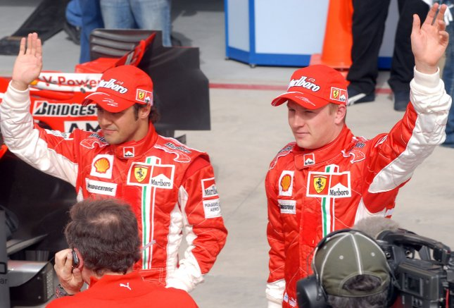 Ferrari's Formula One drivers Felipe Massa (L) and Kimi Raikkonen wave after securing pole and third position during time trials on the second day of practice in Bahrain on April 14, 2007. McLaren's Lewis Hamilton had the second fastest time followed by Massa's team mate Kimi Raikkonen. The Bahrain Formula One Grand Prix will be held on April 15 and will feature 11 teams and 22 drivers. (UPI Photo/Norbert Schiller)