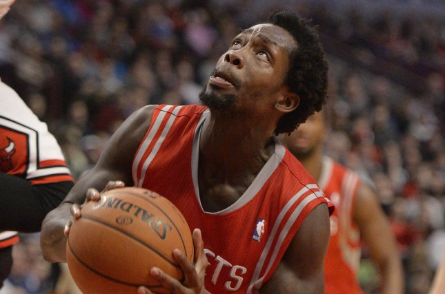 Houston Rockets guard Patrick Beverley (R) goes up for a shot. File photo by Brian Kersey/UPI