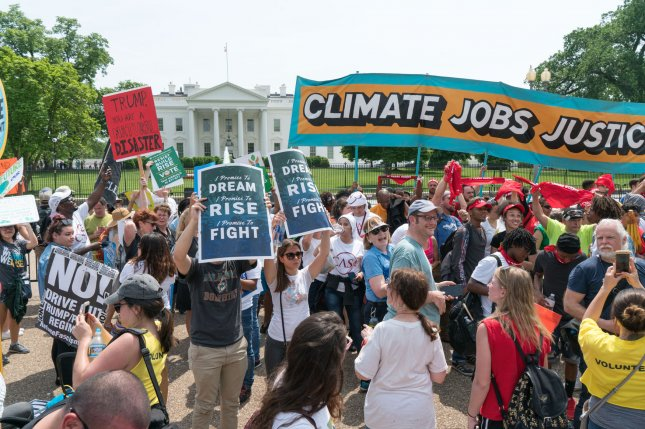 Protesters participate in a demonstration in front of the White House on April 29 for The Peoples Climate Movement, which opposes President Donald Trump's efforts to roll back Obama-era environmental regulations aimed at fighting climate change. File Photo by Ken Cedeno/UPI