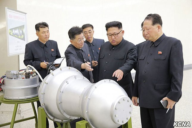 This image released on September 3, 2017, by the North Korean Official News Service (KCNA), shows North Korean leader Kim Jong Un during a briefing by scientists at the Nuclear Weapons Institute on the details of the country's nuclear weaponization program. During the meeting, Kim Jong Un witnessed the loading of a hydrogen bomb into an ICBM missile. Photo courtesy of KCNA/UPI