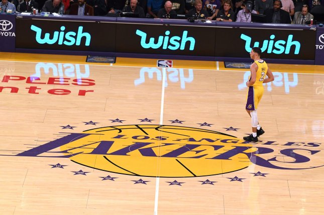 Los Angeles Lakers guard Lonzo Ball stands on the Lakers logo during a game against the Chicago Bulls on November 21 at Staples Center in Los Angeles, Calif. Photo by Jon SooHoo/UPI