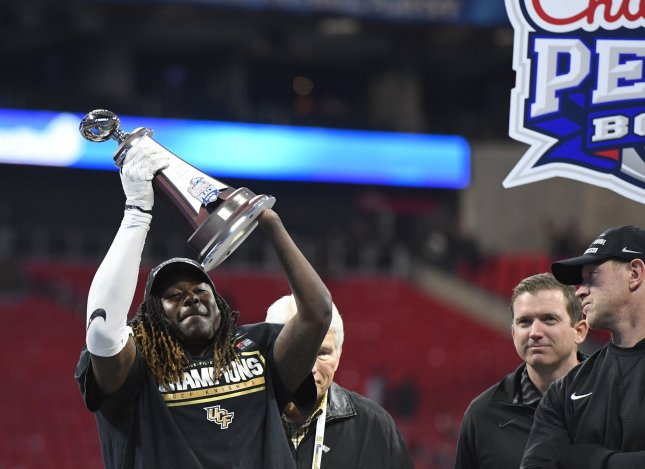 Former Central Florida linebacker Shaquem Griffin celebrates with his most valuable defensive player award after the Chick-fil-A Peach Bowl in January. Griffin was selected by the Seattle Seahawks in this weekend's NFL draft. Photo by David Tulis/UPI