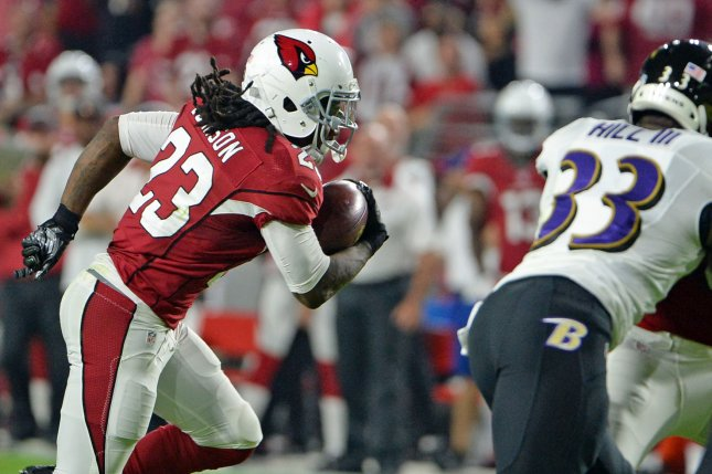 Former Arizona Cardinals running back Chris Johnson (23) heads to the end zone for a touchdown in the first quarter of the Cardinals-Baltimore Ravens game on October 26, 2015 at University of Phoenix Stadium in Glendale, Arizona. File photo by Art Foxall/UPI