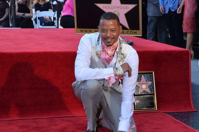 Terrence Howard poses with his star on the Hollywood Walk of Fame on Tuesday. Photo by Jim Ruymen/UPI