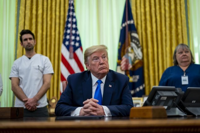 President Donald Trump appears in the Oval Office of the White House on Wednesday to sign a proclamation in honor of National Nurses Day. Photo by Doug Mills/UPI