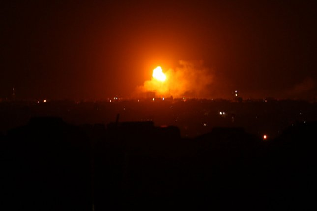 An explosion follows an airstrike by Israel in Rafah in the southern Gaza Strip on Saturday. Photo by Ismael Mohamad/UPI