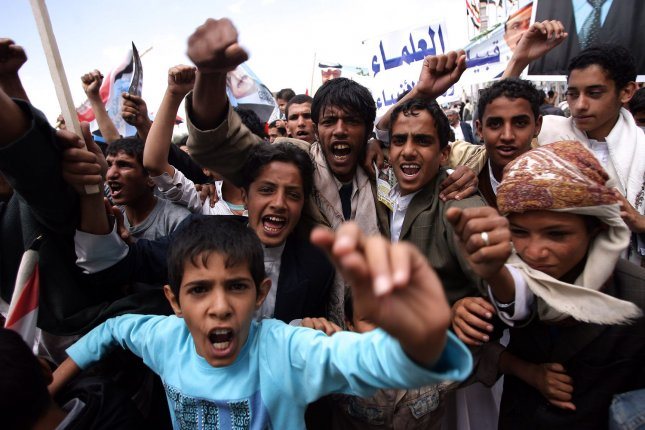 Supporters of Yemen's President Ali Abduallah Saleh hold his picture during a rally in his support in Sanaa, Yemen, September 30, 2011. A Yemeni security official said U.S.-born Imam Anwar al-Awlaki, a leader of al-Qaida in the Arabian Peninsula, was killed in an airstrike while traveling between Marib and al-Jawf provinces, areas known to have an al-Qaida presence. UPI/Abdulrahman Abdallah