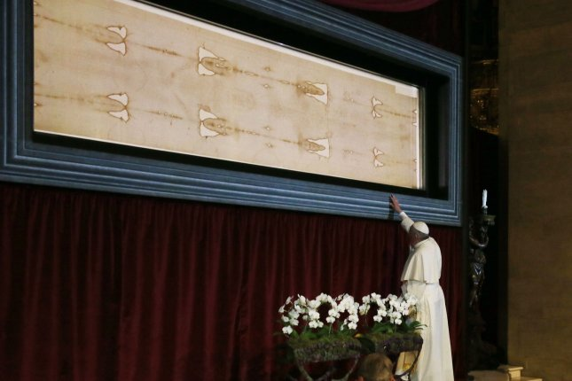 Pope Francis stands in front of the Holy Shroud, believed by some Christians to be the burial shroud of Jesus of Nazareth, on June 21, 2015 in the cathedral in Turin, Italy. Photo by Stefano Spaziani/UPI