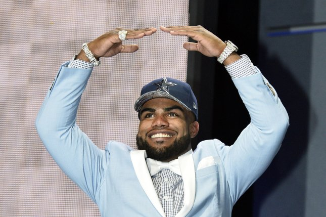 Ohio State running back Ezekiel Elliott walks onto the stage after being selected by the Dallas Cowboys with the fourth overall pick in the 2016 NFL Draft on April 28, 2016 in Chicago. Photo by Brian Kersey/UPIwalks onto the stage after being selected by the Jacksonville Jaguars with the fifth overall pick in the 2016 NFL Draft on April 28, 2016 in Chicago. Photo by Brian Kersey/UPI