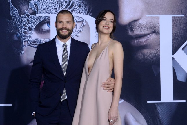 Dakota Johnson (R) and Jamie Dornan at the Los Angeles premiere of Fifty Shades Darker on Thursday. Photo by Jim Ruymen/UPI