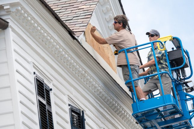 Workers attach hurricane shutters to a historic home along the Charleston Battery in South Carolina to prepare for Hurricane Florence. Experts say the Category 4 storm could cause $170 billion in damage. Photo by Richard Ellis/UPI