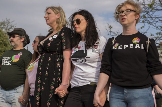 Locals of Galway, Ireland, hold hands during a minute of remembrance for Savita Halappanavar who died in 2012 due to a septic miscarriage. Irish President Michael Higgins signed a bill legalizing abortion up to the 12th week of pregnancy on Thursday. File Photo by Skye McKee/UPI