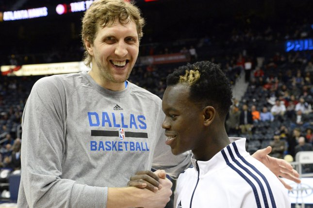 Dallas Mavericks forward Dirk Nowitzki (L), stands with former Atlanta Hawks guard Dennis Schroder. Nowitzki, who is retiring, wrote an emotional good-bye to the fans of Dallas after 21 seasons playing for the Mavericks. File Photo by David Tulis/UPI