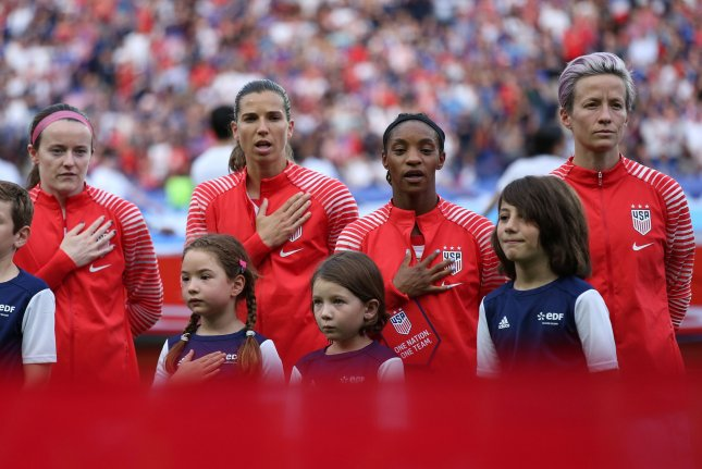 (From L to R) Rose Lavelle, Tobin Heath, Crystal Dunn and Megan Rapinoe of Team USA stand during the U.S. national anthem before the start of a FIFA Women's World Cup match June 28 near Paris, France. File Photo by David Silpa/UPI