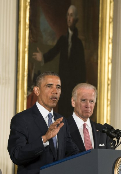 Former President Barack Obama delivers remarks alongside Vice President Joe Biden in January 5, 2015. Authorities arrested a 17-year-old male in Florida accused of targeting the two leaders' Twitter accounts in a cryptocurrency scam. File Photo by Pat Benic/UPI