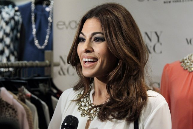 Eva Mendes arrives on the red carpet at the New York & Company Eva Mendes Collection launch event at New York & Company in New York City on September 18, 2013. The actor turns 47 on March 5. File Photo by John Angelillo/UPI