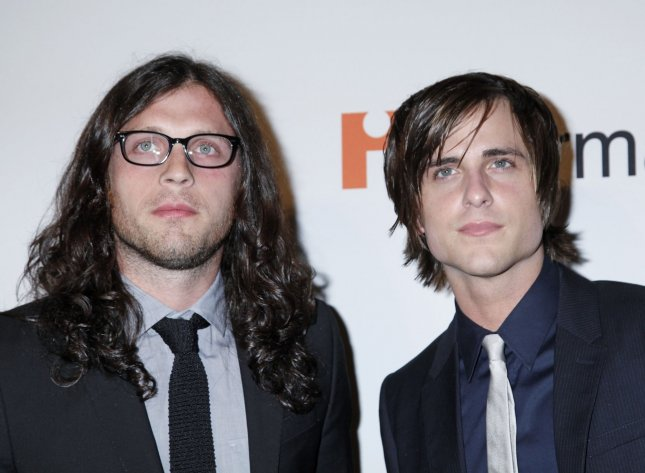 Nathan Followill (L) and Jared Followill of the band Kings of Leon arrive on the red carpet before the annual Clive Davis Pre-Grammy Gala in Beverly Hills, California on January 30, 2010. (UPI/David Silpa)