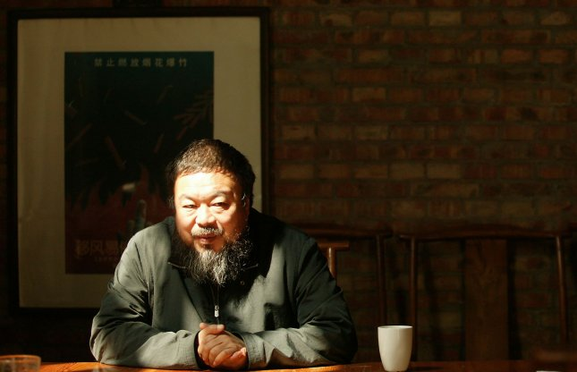 Ai Weiwei, 53, one of China's most prominent avant-garde artists and human rights activists, poses for a portrait in his Beijing studio on April 25, 2009. UPI/Stephen Shaver