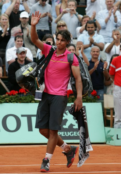 World No. 1 Rafael Nadal waves to the public as he leaves the court after losing his fourth-round match of the French Open near Paris. Nadal was upset May 31, 2009, by Robin Soderling 6-2, 7-6, 6-4, 7-6. On June 9 it was confirmed he has tendonitis in both knees. (UPI Photo/Eco Clement)