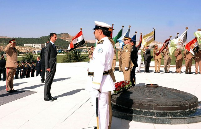 Syrian President Bashar al-Assad (2L) pays his respects at the Tomb of the Unknown Soldier to mark Martyrs' Day in Damascus, Syria on May 6, 2011. UPI/Handout..