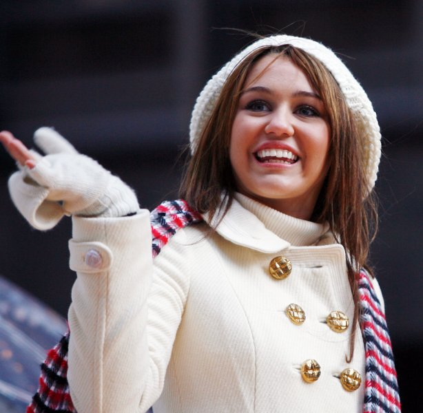 Miley Cyrus rides down the parade route on a float at the Macy's 82nd Thanksgiving Day Parade in New York City on November 27, 2008. (UPI Photo/John Angelillo)