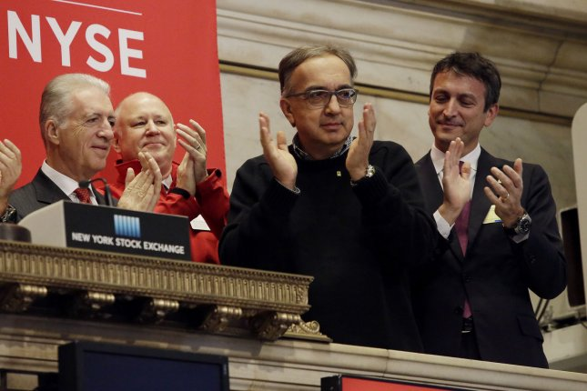 CEO Fiat Chrysler Automobiles Sergio Marchionne, second from right, rings the opening bell Wednesday at the NYSE on the first day of public trading of Ferrari at the New York Stock Exchange on Wall Street in New York City. The company's stock priced its initial public offering at $52 a share after the market close on Tuesday, with sources saying the demand for shares was well oversubscribed. The price was at the top of the previously indicated range of $48 to $52 per share. Ferrari RACE shares were trading at $58.18 up almost 10 percent in its debut on the New York Stock Exchange, above the IPO issue price of $52. Photo by John Angelillo/UPI