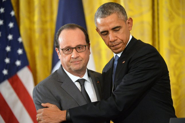 President Barack Obama (L) and French President Francois Hollande embrace during a joint press conference at the White House in Washington, D.C. on November 24, 2015. The two spoke about the coalition combating ISIL. Photo by Kevin Dietsch/UPI