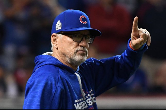 Chicago Cubs manager Joe Maddon makes a pitching change during the eighth inning of World Series game 7 at Progressive Field in Cleveland, Ohio, on November 2, 2016. Photo by Pat Benic/UPI