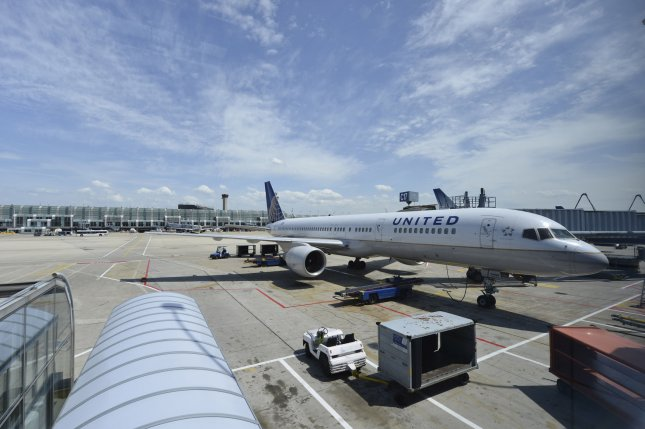 A United Airlines aircraft sits at a gate at O'Hare International Airport in Chicago on May 20, 2013. New Jersey Gov. Chris Christie on Wednesday called for the suspension of overbooking of flights. File Photo by Brian Kersey/UPI