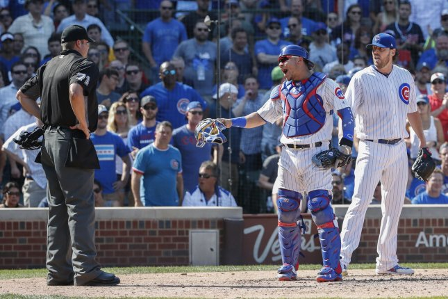 Chicago Cubs Willson Contreras (C) and John Lackey (R) yell at home plate umpire Jordan Baker (L) in the fifth inning of a game against the St. Louis Cardinals at Wrigley Field on September 15, 2017 in Chicago. Photo by Kamil Krzaczynski/UPI