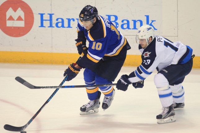 Winnipeg Jets Nic Petan stops St. Louis Blues Scottie Upshall from shooting the puck in the first period at the Scottrade Center in St. Louis on January 31, 2017. Photo by Bill Greenblatt/UPI
