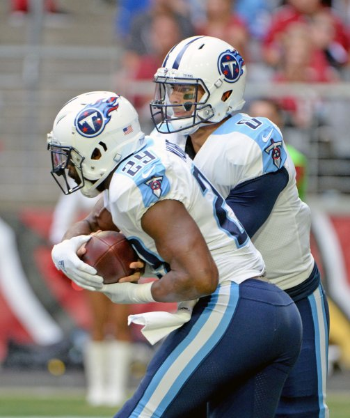 Former Tennessee Titans running back DeMarco Murray takes a handoff from quarterback Marcus Mariota during a game against thew Arizona Cardinals in December. Photo by Art Foxall/UPI