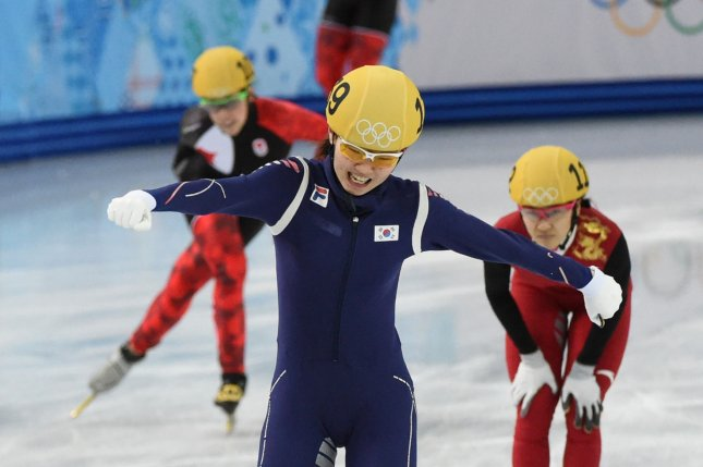 Korea's Shim Suk Hee celebrates as she crosses the finish line to win gold at the 2014 Winter Olympics. She has accused her former coach of raping her, starting when she was 17. File Photo by Molly Riley/UPI