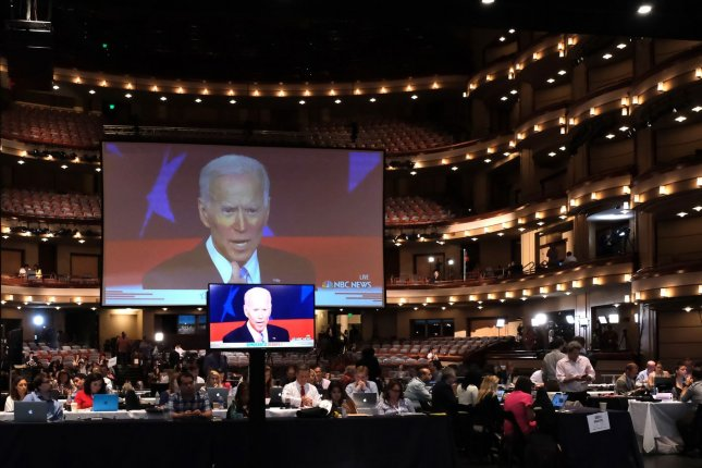 Democratic presidential candidate Joe Biden is seen on screens during a primary debate at the Adrienne Arsht Center for the Performing Arts in Miami, Fla., on June 27, 2019. The venue will host the penultimate debate between Biden and President Donald Trump on October 15. File Photo by Gary I Rothstein/UPI