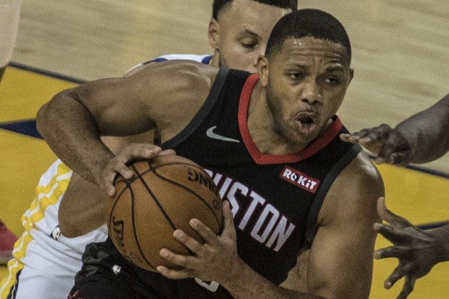 Houston Rockets guard Eric Gordon (10) is in danger of missing the start of the team's resumed regular season after he sustained an ankle injury in a scrimmage Tuesday in Orlando, Fla. File Photo by Terry Schmitt/UPI