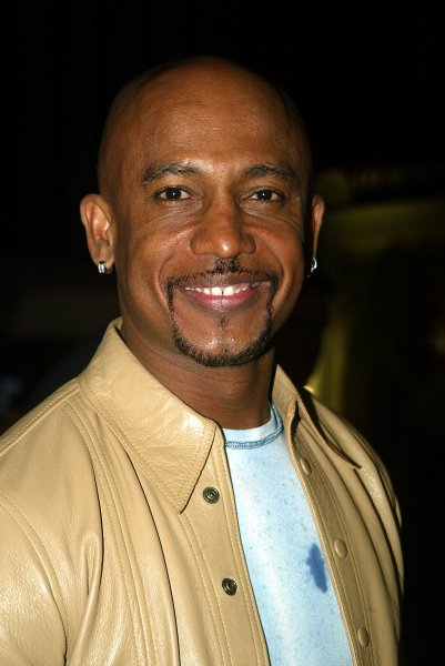 NYP2002100773- NEW YORK, Oct. 7 (UPI) -Montel Williams poses for pictures at the premiere of Brown Sugar at the Ziegfeld Theater in New York on Oct. 7, 2002. rlw/lc/Laura Cavanaugh UPI