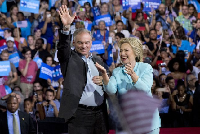Presumptive Democratic presidential nominee Hillary Clinton stands with her pick for vice president, Virginia Sen.Tim Kaine, as he waves to supporters during a rally at Florida International University in Miami. Clinton and Kaine will attend the 2016 Democratic National Convention at the Wells Fargo Center in Philadelphia starting Monday. Photo by Gary I Rothstein/UPI