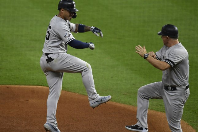 New York Yankees Gleyber Torres (L) celebrates his solo home run with third base coach Phil Nevin against the Houston Astros in the sixth inning of Game 1 of the American League Championship Series at Minute Maid Park in Houston on Saturday. Photo by Trask Smith/UPI